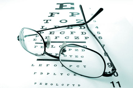photo: glasses resting on eye chart